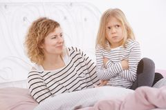Angry little girl. Little girl being angry at her mom Stock Photo