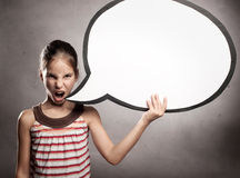Angry little girl holding a speech bubble Royalty Free Stock Image