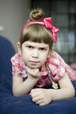 Angry little girl lying Royalty Free Stock Image