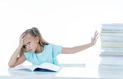Angry little girl with a negative attitude towards studies and school after studying too much and having too many homework in. Children education concept royalty free stock photos