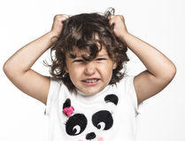 Angry little girl Stock Images