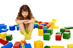Angry little girl among the scattered toys Stock Images