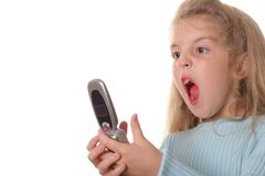 Angry little girl screaming on cellphone Royalty Free Stock Photo