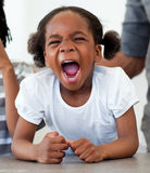 Angry little girl shouting. In the kitchen Stock Images