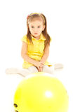 Angry little girl sitting on the floor, looking Stock Photography