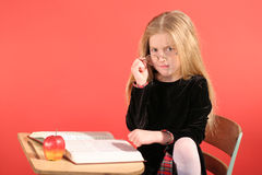 Angry little girl sitting in s Stock Photos