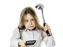 Angry little girl with soup ladle. Isolated on white background Royalty Free Stock Photo