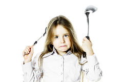 Angry little girl with soup ladle. Isolated on white background Royalty Free Stock Photography
