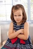 Angry little girl sulking arms crossed Royalty Free Stock Images