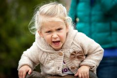 An angry little girl is very disgruntled with something being ph stock images