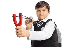 Angry little schoolboy aiming with a slingshot and a rock Royalty Free Stock Image