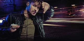 Angry look of handsome man wearing leather jacket. Angry look of handsome guy wearing leather jacket Royalty Free Stock Photo