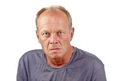 Angry looking man. On a white background Stock Photography