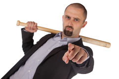 Angry looking man with bat Royalty Free Stock Photography