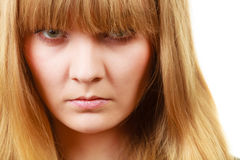 Angry looking woman, face covered in fringe. Expressions, emotions, anger, mysterious concept. Angry looking woman, face covered in her blonde fringe Stock Image