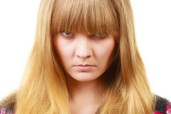 Angry looking woman, face covered in fringe. Expressions, emotions, anger, mysterious concept. Angry looking woman, face covered in her blonde fringe Royalty Free Stock Photos