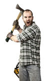 Angry lumberjack. Fine portrait of young caucasian lumberjack with axe Royalty Free Stock Photo