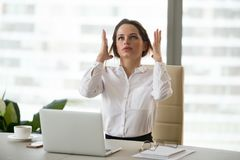 Angry mad businesswoman feeling stressed at work having nervous. Angry mad businesswoman in panic feels stressed at work, frustrated female office employee royalty free stock photos