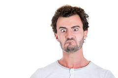 Angry mad crazy looking young man Stock Images