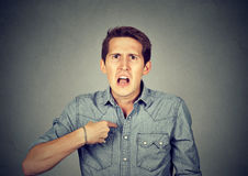 Angry, mad man pointing at himself asking you mean me? Royalty Free Stock Photography