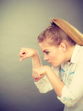 Angry mad woman clenching fist punching on gray. Royalty Free Stock Photo
