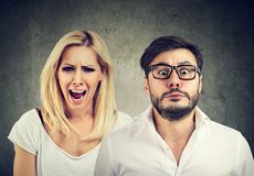 Angry mad woman screaming and fearful man royalty free stock photography