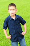 Angry male child. Young boy who is upset with a scowl Stock Photos