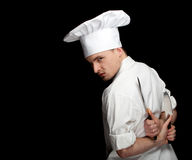 Angry male cook with two knifes Stock Image
