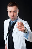 Angry male doctor pointing at you Stock Images