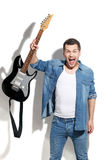 Angry male guitarist expressing negative emotions Royalty Free Stock Photo