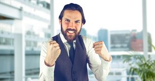 Angry male hipster clenching teeth in city. Digital composite of Angry male hipster clenching teeth in city Stock Photos