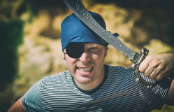 Angry male pirate with sword. Royalty Free Stock Images