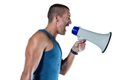 Angry male trainer yelling through megaphone Royalty Free Stock Photography