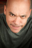 Angry Man. With mean expression and shaved head Stock Images