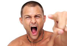 Angry at the Man. Man over white pointing with angry expression Stock Photo