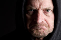Angry Man. Angry old man wearing hoodie stock photos
