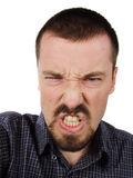 Angry man. Young adult male. Facial expression showing anger Stock Image