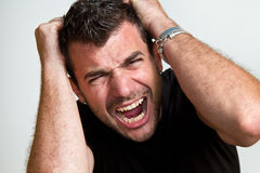 Angry man. An angry young man isolated Royalty Free Stock Image
