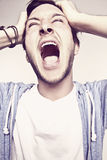 Angry man. Young man with open mouth is very angry royalty free stock images