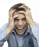Angry man. Depressed or angry man screaming of frustration, headache or stress Stock Image