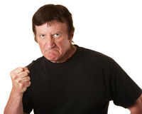 Angry Man. Angry Caucasian man with clenched fist over white background Royalty Free Stock Photo
