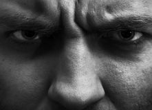 Angry man. Close-up portrait of angry man. In B/W royalty free stock images