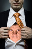 Angry man. Businessman  in black costume throw open one's shirt, inside face with furious grimace Stock Images