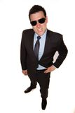 Angry man. A man with an angry expression wearing a suit and sunglasses Stock Images