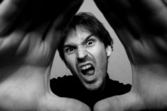 Angry man. Black and white photo of angry man Stock Image