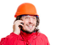 Angry Man architector or builder speaking on mobile over white background Stock Photos