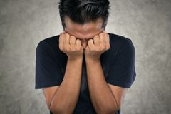 Angry man, Asian men with their hands closed eyes because of anger stock photos