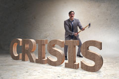 The angry man with axe axing the crisis word Stock Photography