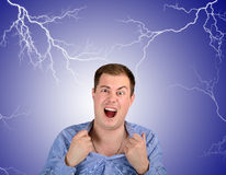 Angry man on background peals of lightning Royalty Free Stock Image