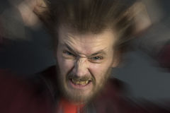 Angry Man. An angry man with a bad temper tearing his hair out Royalty Free Stock Photo